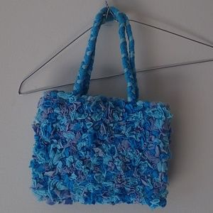 Blue handmade handbag from Ten Thousand Villages